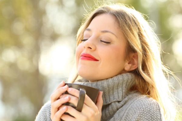 woman breathing fresh air outdoors
